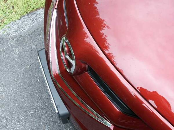 QAA - Mazda Mazda3 2004-2009, 4-door, Hatchback (1 piece Stainless Steel Front Grille Accent Trim ) SG27750 QAA