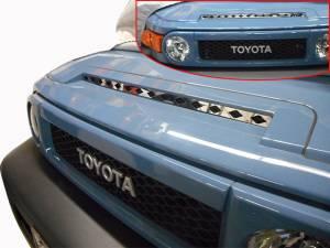 QAA - Toyota FJ Cruiser 2007-2010, 4-door, SUV (1 piece Stainless Steel Front Grille Accent Trim Upper Hood ) SG27142 QAA - Image 1