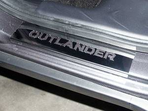 "Chrome Trim - Door Sill Trim - QAA - Mitsubishi Outlander 2007-2009, 4-door, SUV (4 piece Stainless Steel Door Sill trim Includes ""Outlander"" Logo Cut Out ) DS27010 QAA"
